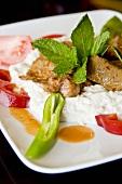 Lamb Kebab Served with Yogurt and Warm Tomato-Butter Sauce