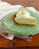 Slice of Lime Chiffon Pie on Stacked Plates