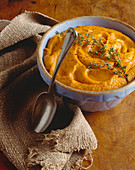 Bowl of Carrot Puree with Thyme Sprig