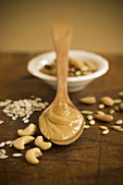 Almond Butter on Wooden Spoon; Nuts