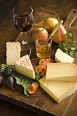 Cheese Wedges with Fruit and Wine on Board