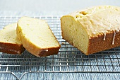 Partially Sliced Lemon Pound Cake on Rack