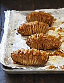Potato Fans; Baked Potatoes Sliced with Bacon and Breadcrumb Topping