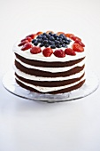 Four Layer Red Velvet Cake with Strawberries and Blueberries