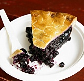 Slice of Blueberry Pie with Piece on Fork