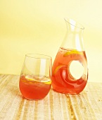 Glass and Pitcher of Cranberry Lemonade