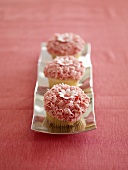 Three Pink Cupcakes with Daisy Decoration
