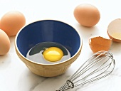 Cracked Egg in a Bowl; Whisk