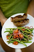 String Bean Salad with Red Onion, Cherry Tomatoes and Grilled Sausage