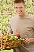 Man Holding a Basket of Organic Produce