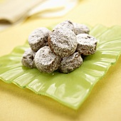 Chocolate Cookies with Powdered Sugar on Green Dish