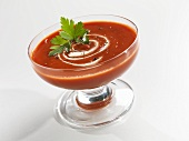 Roasted Tomato Soup with Cream Swirl and Parsley Garnish