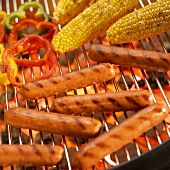 Hot Dogs, Corn Cobs and Peppers on Grill