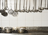 Cooking Utensils Hanging in Kitchen