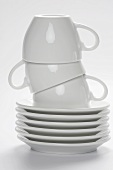 Stacked White Coffee Cups and Saucers