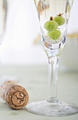 Champagne Cork with Glass of Prosecco