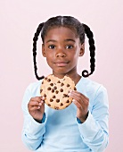 Girl Holding Chocolate Chip Cookie with Bite Taken Out