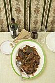 Coq au Vin on Table with Red Wine