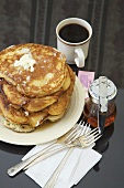 Tall Stack of Pancakes with Butter; Syrup and Coffee