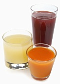 Three Glasses of Assorted Juice; White Background