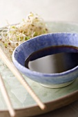 Soy Sauce in Ceramic Bowl with Sprouts