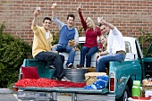 Friends Making a Toast at a Tailgating Party from the Back of a Pickup