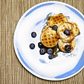 Mini Waffles with Blueberries and Maple Syrup