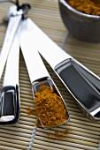 Turmeric Powder in Measuring Spoon