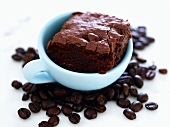 Brownie in Coffee Cup with Coffee Beans