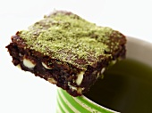 Pistachio Brownie on Rim of Coffee Cup