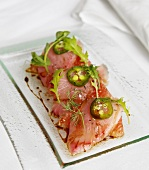 Hamachi Crudo (raw fish fillets with grapefruit and jalapeno, Japan)