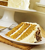 Slice of Layered Carrot Cake with Cream Cheese Frosting