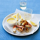 Cracked Crab Legs with Melted Butter and Lemon Wedges