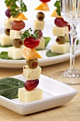 Three Cheese Canapes with Olives, Cherry Tomatoes and Grapes
