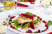 Grilled Chicken Breast on Steamed Vegetables with Red Currant Sauce