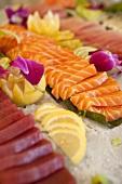 Tuna and Salmon Sashimi  with Lemon Wedges