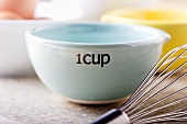 Water in One Cup Measuring Cup; Whisk