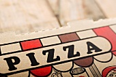 Close Up of the Word Pizza on Pizza Take Out Box