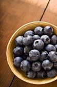 Small Bowl of Organic Blueberries on Wooden Table