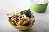Small Bowl of Classic Pasta Salad with Wooden Spoon