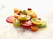 Assorted Sliced Tomatoes with Olive Oil, Ground Pepper and Herbs
