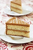 Slice of sponge cake with caramel buttercream icing