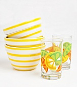 Yellow Striped Bowls with Colorful Juice Glasses
