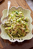 Sliced Brussels Sprouts on Serving Platter; Serving Spoon