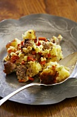 Spoonful of Bread Stuffing on Pewter Plate