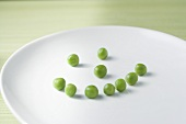Peas Forming a Smiley Face on a White Plate