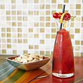 Cherry Blossom Drink with Bowl of Smoked Almonds
