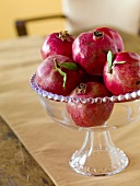 Pomegranates in a Glass Pedestal Bowl
