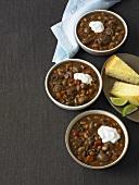 Three Bowls of Vegetarian Chili; Corn Bread