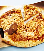 Cheese Pizza Being Sliced